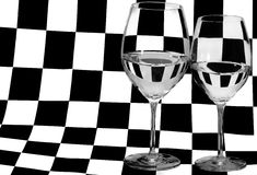 Two glasses on black and white square background Stock Photo