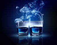 Two glasses of blue cocktail Stock Images