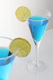 Two glasses of blue cocktail Royalty Free Stock Photos