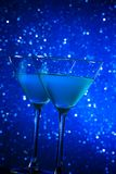 Two glasses of blue cocktail on table Royalty Free Stock Photos