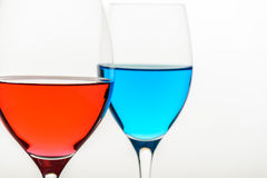 Two glasses with blue colored water and wine Stock Photo