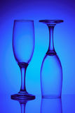 Two glasses in blue light Stock Photos