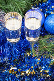 Two glasses with blue Xmas decorations and tree 4 Royalty Free Stock Image