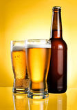 Two glasses and Bottle of fresh light beer Royalty Free Stock Photography