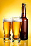 Two glasses and Bottle of fresh light beer Stock Photography