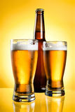 Two glasses and Bottle of fresh light beer Stock Photos