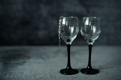 Two glasses with a bracelet. Two glasses with a silver bracelet Royalty Free Stock Photo