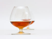 Two glasses of brandy. One behind another Stock Photo
