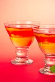Two glasses with bright fruit jelly closeup Royalty Free Stock Photo