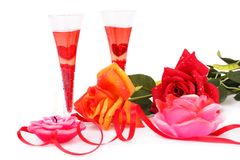 Valentine`s day. Two glasses, candles and roses  isolated on white background Royalty Free Stock Images