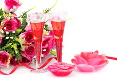 Valentine`s day decoration. Two glasses, candles and roses  isolated on white background Stock Images