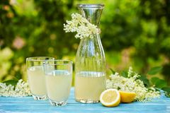 Two glasses and a carafe of elderflower lemonade. On table Stock Images