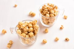 Two glasses of caramel popcorn. stock photos
