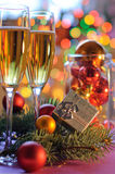 Two glasses of champagne. And a New Year's decoration Royalty Free Stock Images