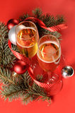 Two glasses of champagne. And a New Year's decoration Stock Image