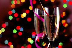 Two Glasses of Champagne. Against Blured Christmass Lights. Shallow Depth of Field Stock Photo