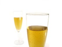 Two glasses of champagne. Close-up of two glasses of champagne. One in focus, the other blured royalty free stock images