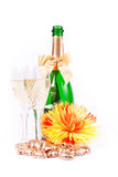 Two glasses of champagne. With сhrysanthemum and candies on white background Stock Images