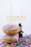 Two glasses with champagne. With confetti and cake and figurines royalty free stock photos