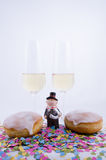 Two glasses with champagne. With confetti and cake and figurines Stock Photo