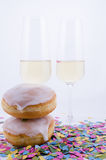 Two glasses with champagne. With confetti and cake Stock Photos