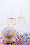 Two glasses with champagne. With confetti stock photo