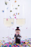 Two glasses with champagne. With confetti and figurines Stock Photography
