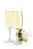 Two glasses champagne. And bouquet flowers on white background Royalty Free Stock Photos