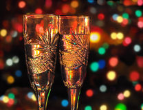 Two glasses with champagne against festive background Stock Photos