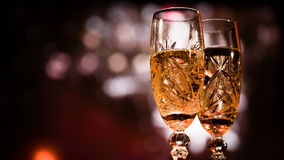 Two glasses with champagne against salute and bengal light. Christmas video close up stock video