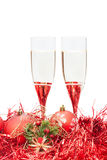 Two glasses of champagne and angel figure at red Royalty Free Stock Photography