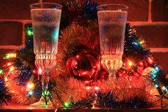 Two glasses of champagne on a background of Christmas decorations Royalty Free Stock Photography