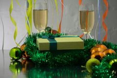 Two glasses of champagne on the background of Christmas decorations Royalty Free Stock Photography