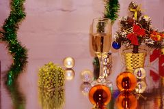 Two glasses of champagne on the background of the Christmas tree and ornaments. stock photos