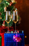 Two glasses of champagne on background christmas tree. Selective focus Royalty Free Stock Photos