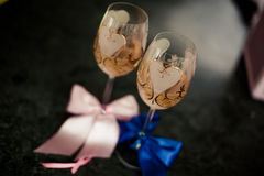 Two glasses of champagne on the background of the wedding bouquet of pink roses. Soft focus, selective focus Royalty Free Stock Photos