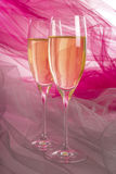Two Glasses of Champagne with Backlit Tulle Background #1 royalty free stock photo