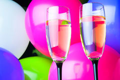 Two glasses of champagne and balloons on party Stock Images
