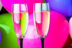 Two glasses of champagne and balloons on party Royalty Free Stock Images