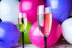 Two glasses of champagne and balloons on party Stock Photo