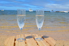 Two Glasses Of Champagne On the Beach In Paradise Island Royalty Free Stock Images