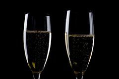 Two glasses champagne on black macro Stock Images