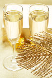 Two glasses of champagne on the blurred background. Royalty Free Stock Photos