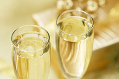 Two glasses of champagne on the blurred background. Stock Photos