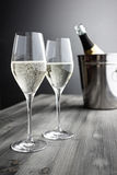Two glasses of Champagne, Bottle and Cooler Stock Images