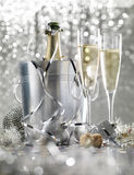 Two glasses of champagne with bottle in cooler stock images