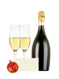 Two glasses of champagne, bottle, greeting card and red christma. S ball isolated on white background Stock Image