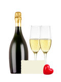 Two glasses of champagne, bottle, greeting card and red heart Royalty Free Stock Images
