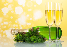 Two glasses of champagne with bottle on yellow New Stock Image