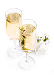 Two glasses of champagne and bouquet flowers Royalty Free Stock Images